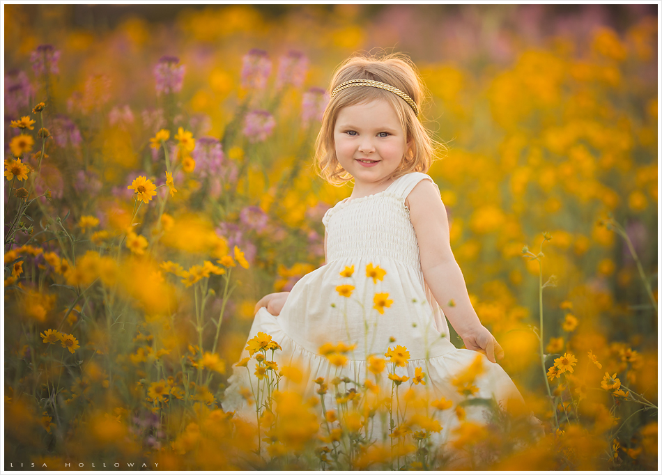 Family photo session in wildflowers in Arizona. LJHolloway Photography is a Las Vegas Family Photographer.