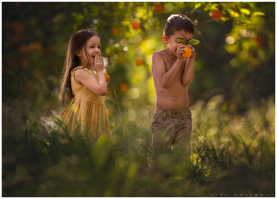 A little boy and girl play in an orange grove. LJHolloway photography is a Las Vegas Child Photographer.