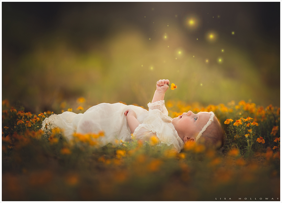 Baby girl lies in yellow flowers. LJHolloway photography is a Las Vegas Child Photographer.