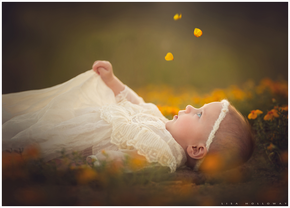 Baby girl lays in yellow flowers. LJHolloway photography is a Las Vegas Child Photographer.