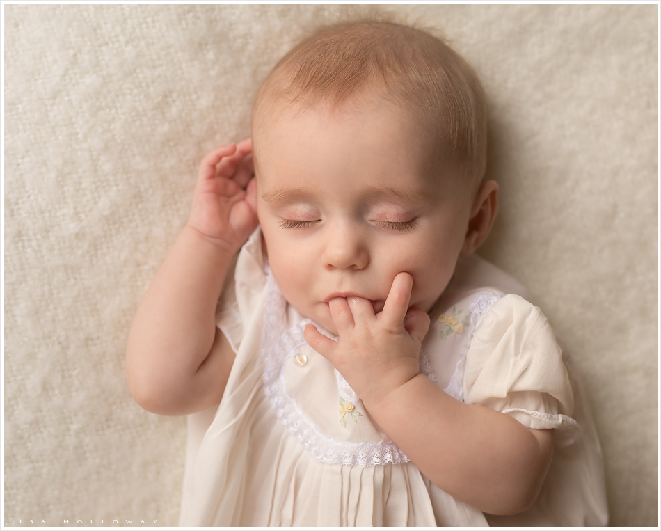 Baby girl sleeps while sucking her fingers. LJHolloway Photography is a Las Vegas Child Photographer.