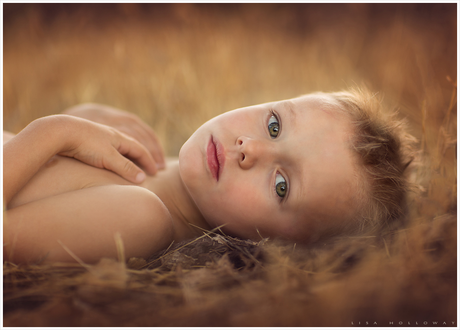 Cute little boy with green eyes. LJHolloway photography is a Las Vegas Child Photographer.