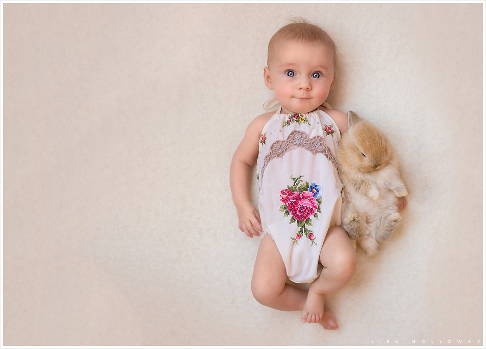 Baby girl holds a baby bunny. LJHolloway photography is a Las Vegas Child Photographer.