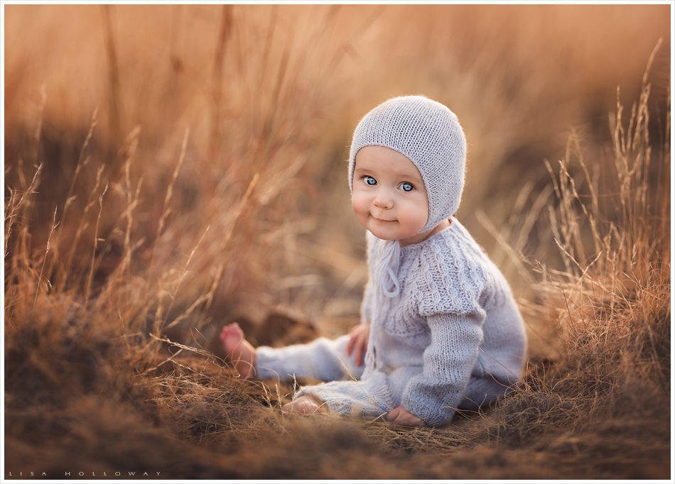 Sweet baby girl with a knit jumper and hat has her portrait taken outdoors. LJHolloway Photography is a Las Vegas Baby Photographer.