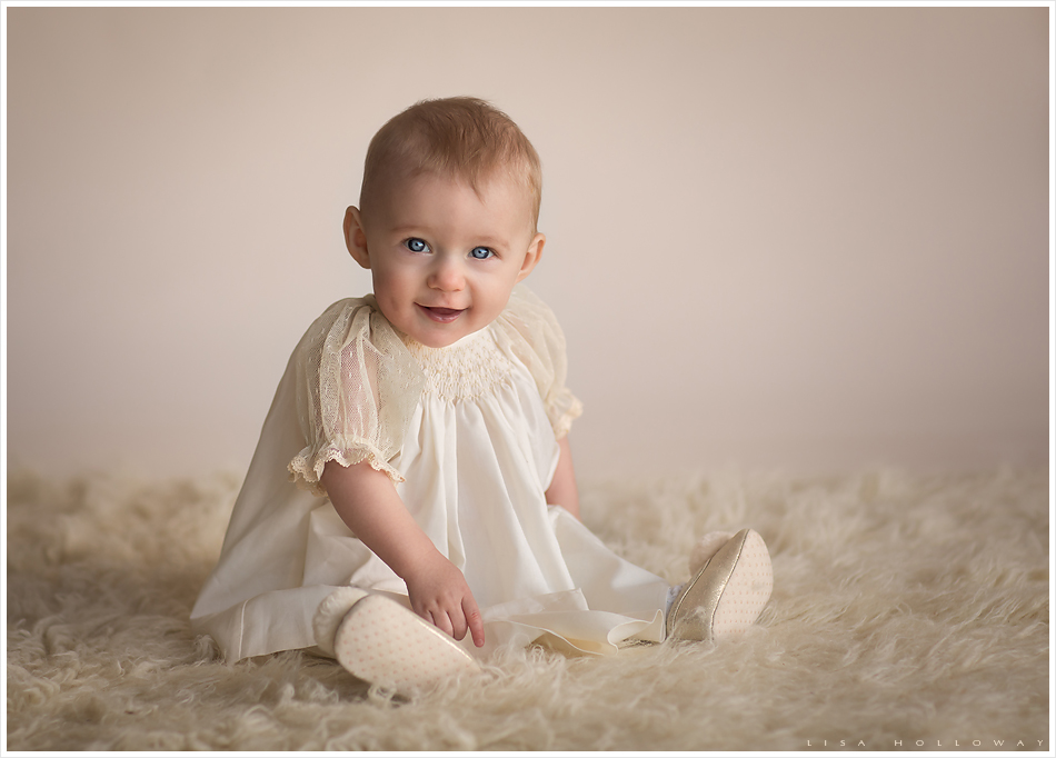 Beautiful baby girl with blue eyes has her picture taken in studio ljholloway photography is