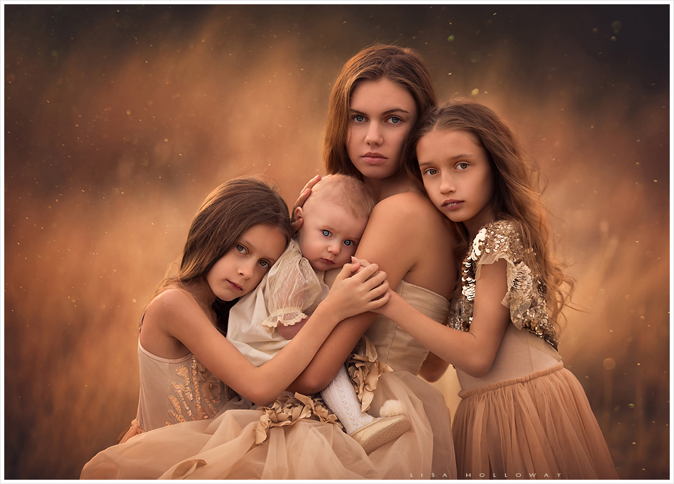 Golden outdoor portrait of 4 sisters. LJHolloway Photography is a Las Vegas Family Photographer.