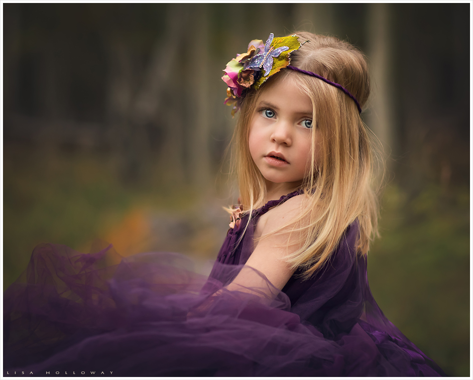 Cute little blonde girl in a purple fairy dress and crown. LJHolloway Photography is a Las Vegas Child Photographer.
