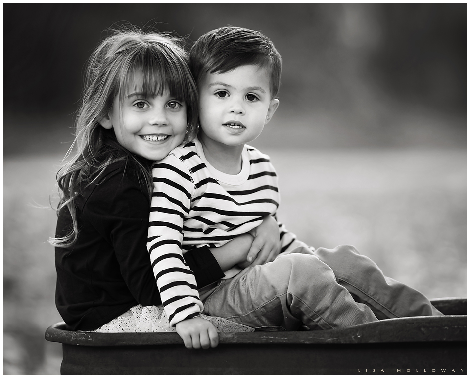 Cute brother and sister in a vintage wagon. LJHolloway Photography is a Las Vegas Family Photographer.