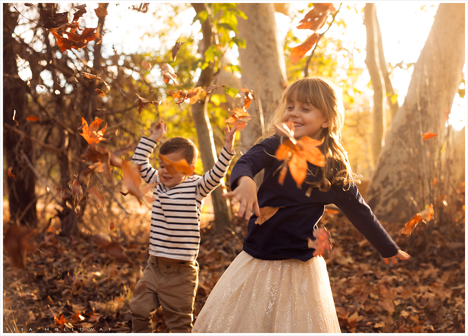Brother and sister throw leaves. LJHolloway Photography is a Las Vegas Child Photographer.