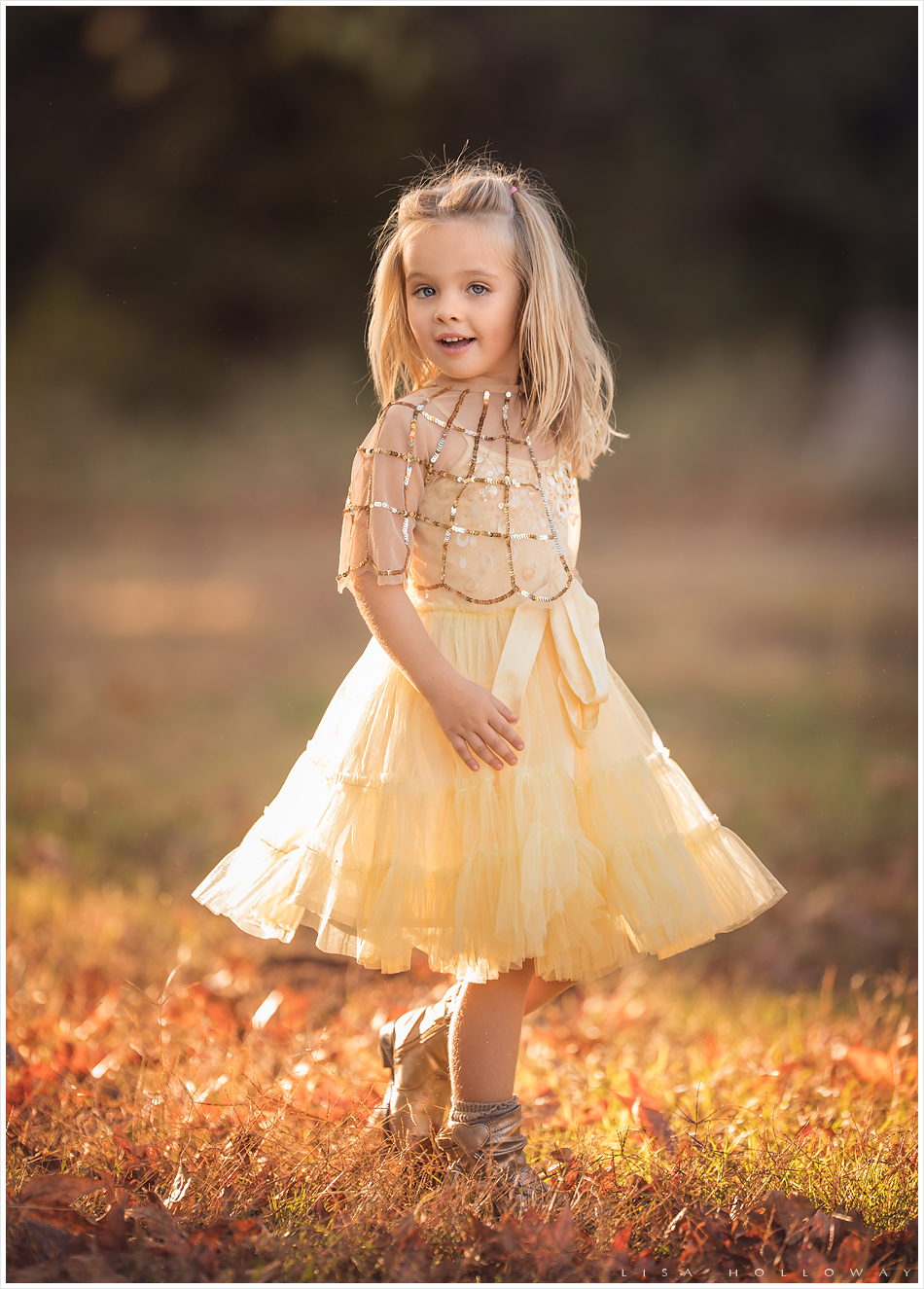 Adorable little girl in yellow dress twirls in the sun. LJHolloway Photography is a Las Vegas Family Photographer.