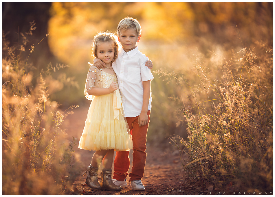 Beautiful family has their portrait taken outdoors in the autumn leaves. LJHolloway Photography is a Las Vegas Family Photographer.