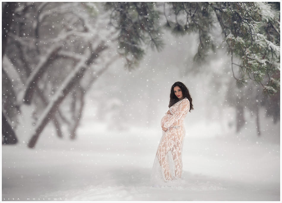 Beautiful pregnant woman in a lace dress in the snow. LJHolloway Photography is a Las Vegas Maternity Photographer.