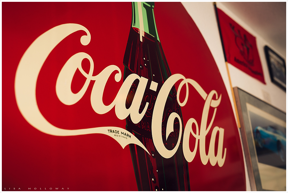 Vintage Coca Cola sign, detail image. Retro fashion 1950's shoot.