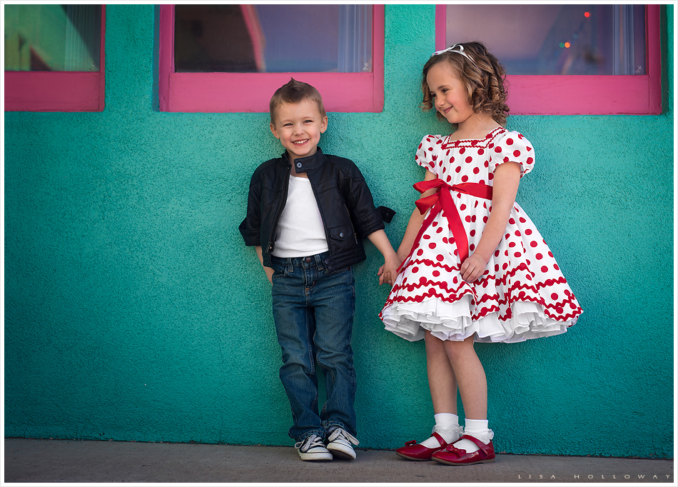 Cute little boy and girl dressed as Shirley Temple and James Dean pose outside of a retro 1950's diner on Route 66 in Kingman Arizona. LJHolloway Photography is a Las Vegas Children's Photographer.